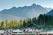 Redfish Lake near Stanley, Idaho. People on the dock at Redfish Lake Lodge with the Sawtooth mountains beyond.