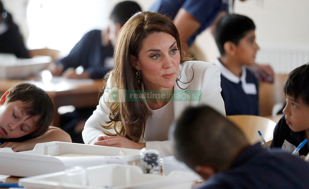 The Duchess of Cambridge listens to children during a lesson which focused on plastic in the sea at the 1851 Trust charity's final Land Rover BAR Roadshow at Docklands Sailing and Watersports Centre in London.