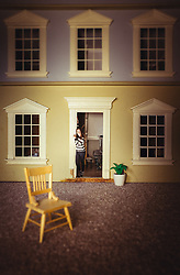 Girl in a Dolls' House.  Photo-composite shot using the subject's own dolls' house