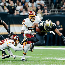 Nov 19, 2017; New Orleans, LA, USA; New Orleans Saints running back Mark Ingram (22) is tripped up by Washington Redskins safety D.J. Swearinger (36) during the second half of a game at the Mercedes-Benz Superdome. The Saints defeated the Redskins 34-31 in overtime. Mandatory Credit: Derick E. Hingle-USA TODAY Sports