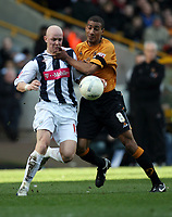 Photo: Rich Eaton.<br /> <br /> Wolverhampton Wanderers v West Bromwich Albion. The FA Cup. 28/01/2007. West Broms Richard Chaplow left and Wolves captain Karl Henry clash on the ball