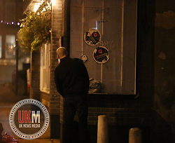 Manchester UK  24.12.2016: Images from Manchesters Gay Village during the Mad Friday celebrations this on the 23 and 24th of December,<br /> <br /> <br />  A man urinates against a club wall whilst appearing to look to make sure he can not be seen