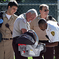 10/02/08-Boston,MA) After fearing the worst, Boston Emergency Medical Services personnel who responded  to a report of car accident with a seriously injured infant, seem relieved to find a healthy, apparently cute child.