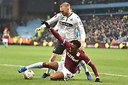 Swansea City defender Mike Van Der Hoorn (5) battles for possession  with Aston Villa striker Jonathan Kodjia (26) during the The FA Cup 3rd round match between Aston Villa and Swansea City at Villa Park, Birmingham, England on 5 January 2019.