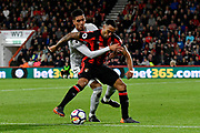 Chris Smalling (12) of Manchester United holds Callum Wilson (13) of AFC Bournemouth during the Premier League match between Bournemouth and Manchester United at the Vitality Stadium, Bournemouth, England on 18 April 2018. Picture by Graham Hunt.