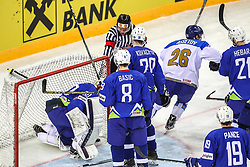 Alikhan Assetov of Kazakhstan scored vs Gasper Kroselj of Slovenia during Ice Hockey match between National Teams of Kazakhstan and Slovenia in Round #4 of 2018 IIHF Ice Hockey World Championship Division I Group A, on April 27, 2018 in Arena Laszla Pappa, Budapest, Hungary. Photo by David Balogh / Sportida