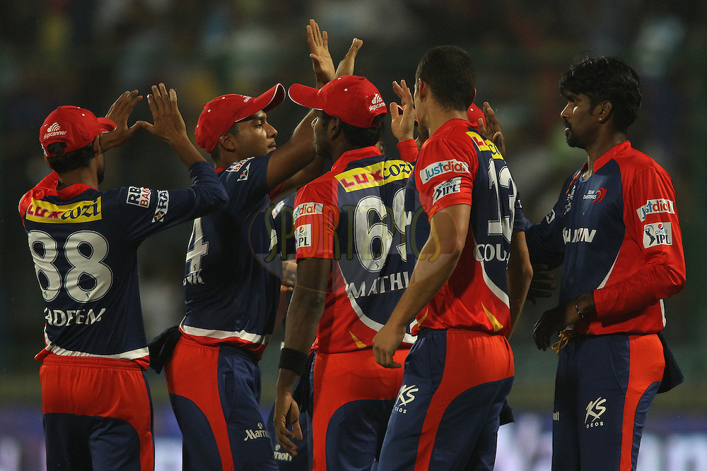 Delhi Daredevils captain Jean-Paul Duminy and Domnic Joseph Muthuswamy of the Delhi Daredevils are congratulated for getting Lendl Simmons of Mumbai Indians wicket during match 21 of the Pepsi IPL 2015 (Indian Premier League) between The Delhi Daredevils and The Mumbai Indians held at the Ferozeshah Kotla stadium in Delhi, India on the 23rd April 2015.<br /> <br /> Photo by:  Shaun Roy / SPORTZPICS / IPL