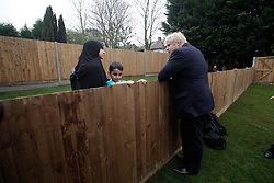 © Licensed to London News Pictures. 03/04/2014. London, UK. Boris Johnson inside a new council house. Residents of Barnet protest outside the Community Center against the Mayor of london Boris Johnson who is attenting for the inauguration of new council houses. Photo credit : Andrea Baldo/LNP