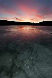 """Frozen Prosser Reservoir Sunset 4"" - A colorful sunset photograph of an icy frozen over Prosser Reservoir in Truckee, CA."