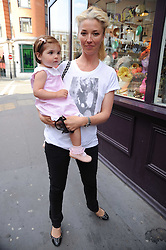 TAMARA VERONI and her daughter VIOLET at Papillon Shoes Enchanted Tea Party Store Launch 98 Marylebone Lane, London W1 on 25th May 2010.