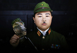 Member of 'Longzaitian' or 'Dragon in the Sky' Shadow Puppet Troupe Lu Peigang, 29, dressed as a Japanese soldier poses for a photo with this puppet while waiting backstage in a rehearsal for a show titled 'Findling the Anti-Japanese Hero' in Beijing, China, 29 May 2015. The troupe which consists of about 50 members who look like children but are actually dwarfs with an average age of 22 and height of 1.26 metres. Formed in 2008, the troupe started out with less than ten members but gradually grew in fame and stature, drawing many other dwarfs from all parts of China who seek to be accepted in a community of their own. The troupe provides training, food, accommodation and income for the members as well as a sense of belonging and pride in their work preserving the ancient art of shadow puppetry. Dwarfs have traditionally been viewed as disabled people in China and are often discriminated by mainstream society.