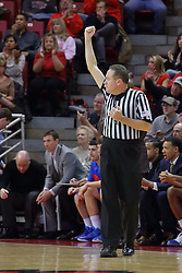 22 December 2013:  referee Mark Whitehead during an NCAA  mens basketball game between the Blue Demons of DePaul falling to  the Illinois State Redbirds 69-64 in Redbird Arena, Normal IL