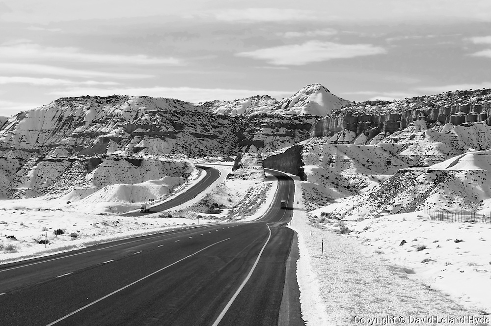 Interstate 70, Snow on Molen Reef, Utah Canyons, Southwest Desert, North American Desert, sage plant, low winter sun, sandstone rock, hoodoo rocks, erosion landforms