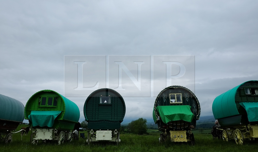 © Licensed to London News Pictures. <br /> 05/06/2014. <br /> <br /> Appleby, Cumbria, England<br /> <br /> Bow top wagons line up as gypsies and travellers gather during the annual horse fair on 5 June, 2014 in Appleby, Cumbria. The event remains one of the largest and oldest events in Europe and gives the opportunity for travelling communities to meet friends, celebrate their music, folklore and to buy and sell horses.<br /> <br /> The event has existed under the protection of a charter granted by King James II in 1685 and it remains the most important event in the gypsy and traveller calendar.<br /> <br /> Photo credit : Ian Forsyth/LNP