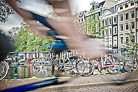View of a biker passing by in Amsterdam.