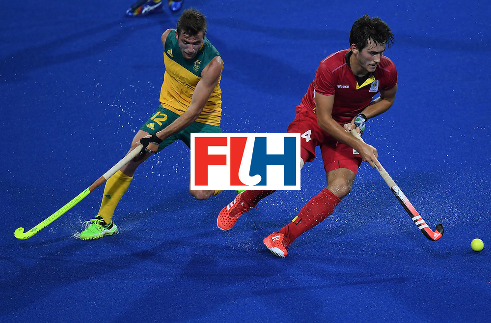 Belgium's Arthur van Doren (R) controls the ball as Australia's Jake Whetton looks on during the men's field hockey Belgium vs Australia match of the Rio 2016 Olympics Games at the Olympic Hockey Centre in Rio de Janeiro on August, 9 2016. / AFP / MANAN VATSYAYANA        (Photo credit should read MANAN VATSYAYANA/AFP/Getty Images)