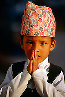 """Nepalese boy making """"namaste"""" gesture, Durbar Square, Kathmandu, Nepal"""