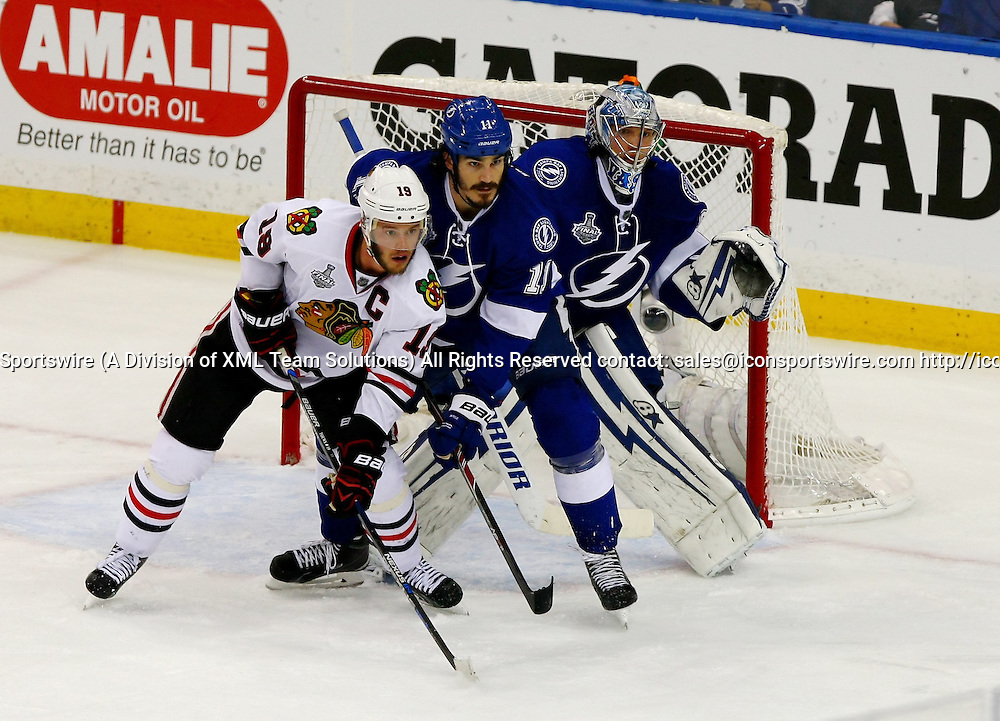 June 06 2015: Chicago's Jonathan Toews (19) and Tampa Bay's Brian Boyle (11) and Ben Bishop (30) all line up in front of the Tamps net in game two of the 2015 Stanley Cup Finals between the Chicago Blackhawks and the Tampa Bay Lightning at Amalie Arena in Tampa, Florida.
