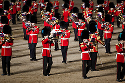 © Licensed to London News Pictures. LONDON, UK  08/06/11. A musician changes his sheet music as the Massed Bands of the Guards Division perform during the opening night of Beating the Retreat on Horse Guards Parade.  This year the opening night of Beating the Retreat took place with the American Ambassador receiving the salute. The traditional parade, involving all of the bands of the Household Division of the British Army, dates back to times when, after a day's battle, troops would retreat for the night.  Please see special instructions for usage rates. Photo credit should read Matt Cetti-Roberts/LNP