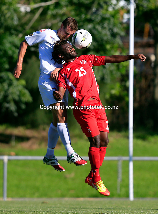 Amicale's Joses Nawo goes one on one with Waitakere's Aaron Scott. OFC Champions League 2013, 2nd Leg Semi Final, Waitakere United v Amicale FC, Fred Taylor Park Waitakere, Sunday 12th May 2013. Photo: Shane Wenzlick