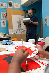 Prisoner in an art class