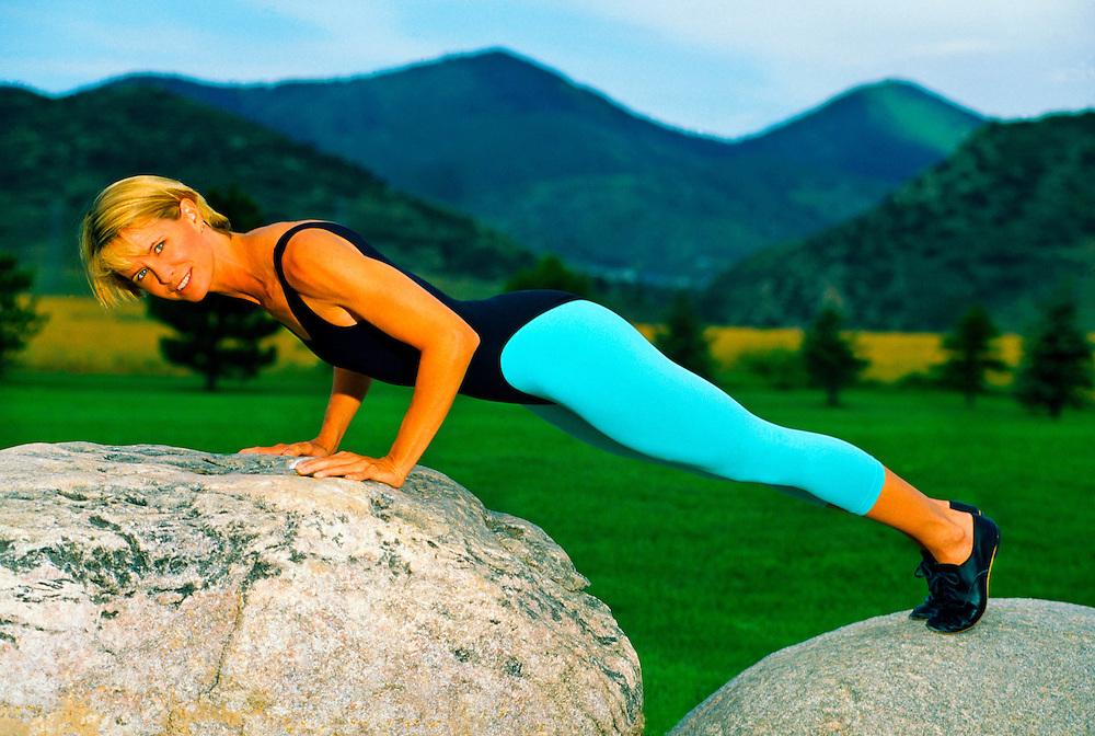 Woman doing push ups, Littleton, Colorado