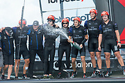 The Great Sound, Bermuda 12th June 2017. Emirates Team New Zealand sailors celebrate with Team Principal Matteo DeNora (#rd from L) and Sir Stephen Tindall (1st on left) after winning the Louis Vuitton America's Cup Challenger series.