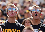 September 11 2010: Iowa fans cheer before the start of the NCAA football game between the Iowa State Cyclones and the Iowa Hawkeyes at Kinnick Stadium in Iowa City, Iowa on Saturday September 11, 2010. Iowa defeated Iowa State 35-7.
