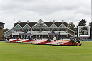 The covers come on as rain stops play during the Specsavers County Champ Div 1 match between Somerset County Cricket Club and Essex County Cricket Club at the Cooper Associates County Ground, Taunton, United Kingdom on 23 September 2019.