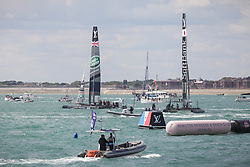 © Licensed to London News Pictures. 25/07/2015. Portsmouth, UK. Team Land Rover BAR (left) after their win in the first race of the first leg of the America's Cup World Series in Portsmouth this weekend. Today, 25th July 2015, is the first race day in which British Olympic sailing legend, Sir Ben Ainslie, will be leading his all-British team, Land Rover BAR, against other teams in a battle to qualify for a place in the two team America's Cup final, to be held in Bermuda in 2017.  Photo credit : Rob Arnold/LNP
