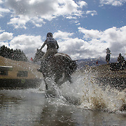 Toni Finch riding Free Ride Home in action at the water jump during the Cross Country event at the Wakatipu One Day Horse Trials at the Pony Club grounds,  Queenstown, Otago, New Zealand. 15th January 2012. Photo Tim Clayton