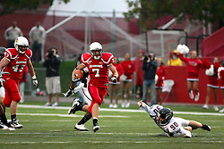 25 September 2010:  Cutting through the left side, Ben Ericksen makes Austin Witmer slip and miss.  The Missouri State Bears lost to the Illinois State Redbirds 44-41 in double overtime, meeting at Hancock Stadium on the campus of Illinois State University in Normal Illinois.