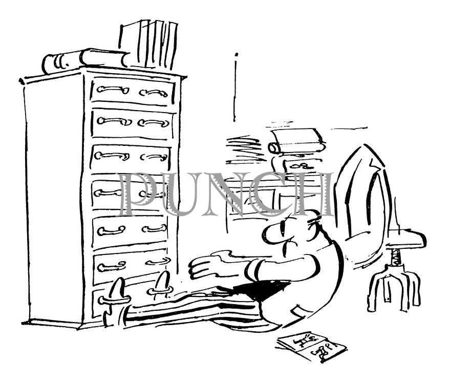 (Man in an office uses the handles on a chest of drawers to hold his feet as he does his sit ups)