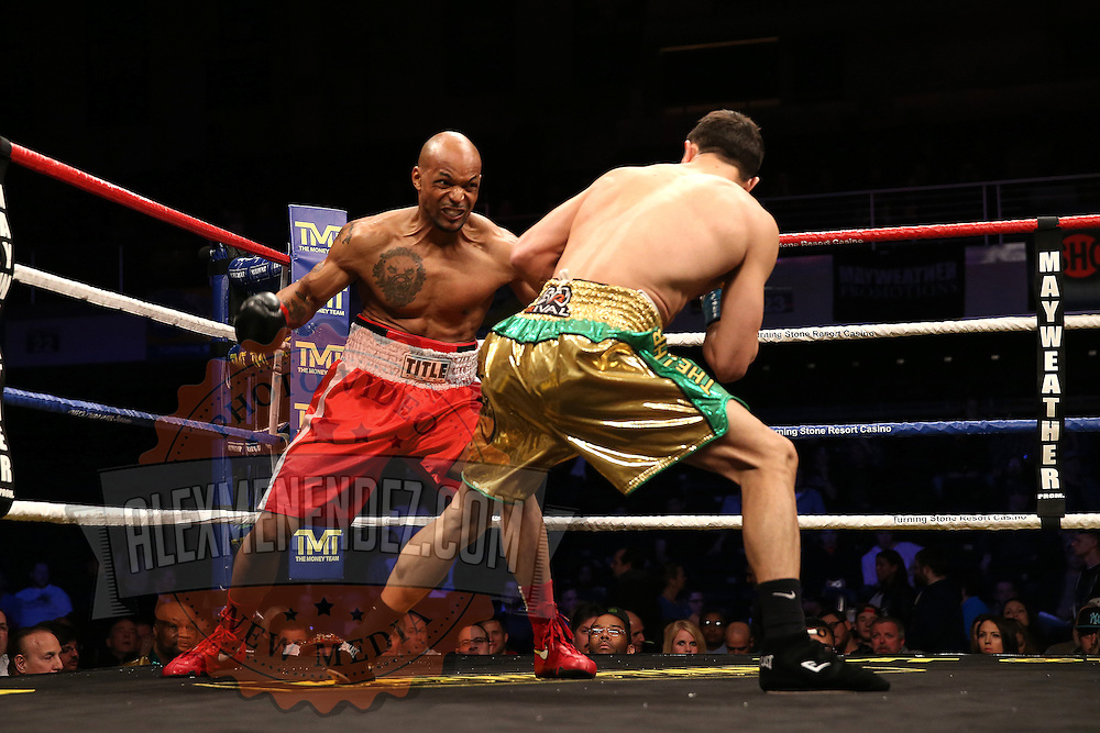 Ronald Gavril (green) and Cameron Allen (red) fight during Showtime Televisions ShoBox:The Next Generation boxing match at the Event Center at Turning Stone Resort Casino on Friday, February 28, 2014 in Verona, New York.  (AP Photo/Alex Menendez)