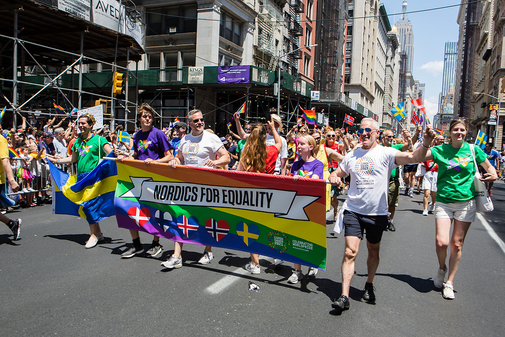 New York, NY - 30 June 2019. The New York City Heritage of Pride March filled Fifth Avenue for hours with participants from the LGBTQ community and it's supporters. Marchers bear a banner for Nordics for Equality.