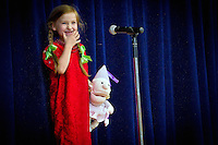 "Bella Mitchell prepares her smile before singing the song ""Miss Lucy"" during the Borah Elementary talent show Tuesday."