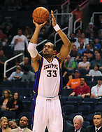Apr. 11, 2011; Phoenix, AZ, USA; Phoenix Suns forward Grant Hill (33) puts up a shot against the Minnesota Timberwolves at the US Airways Center. The Suns defeated the Timberwolves 135 -127 in overtime. Mandatory Credit: Jennifer Stewart-US PRESSWIRE.