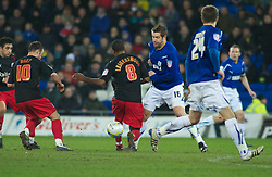 CARDIFF, WALES - Tuesday, February 1, 2011: Cardiff City's Jonathan Parkin is fouled by Reading's Mikele Leigertwood for a free kick in the last minute of the match during the Football League Championship match at the Cardiff City Stadium. (Photo by Gareth Davies/Propaganda)