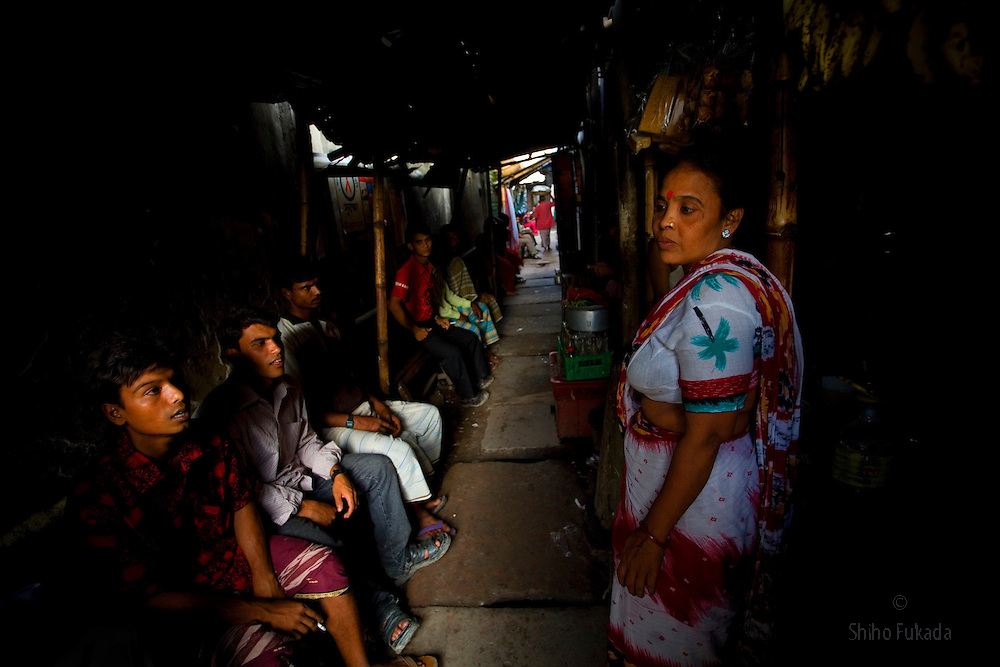 "Aging sex worker Josna, 60, tries to get a cutomer at brothel in Faridpur, Bangladesh. As she ages, she finds difficult to get a customer. ""I grab and pull a customer into my room and just reveal myself."" she says."