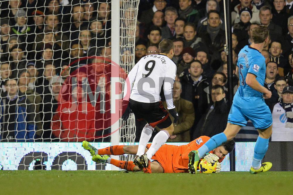 Tottenham's Hugo Lloris makes a save at the feet of Fulham's Dimitar Berbatov - Photo mandatory by-line: Mitch Gunn/JMP - Tel: Mobile: 07966 386802 04/12/2013 - SPORT - Football - Craven Cottage - London -  Fulham v Tottenham Hotspur - Barclays Premier League