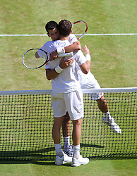 04.07.2014, All England Lawn Tennis Club, London, ENG, ATP Tour, Wimbledon, im Bild Novak Djokovic (SRB) embraces Grigor Dimitrov (BUL) after winning the Gentlemen's Singles Semi-Final match 6-3, 3-6, 7-6 (2), 7-6 (7) on day eleven // during the Wimbledon Championships at the All England Lawn Tennis Club in London, Great Britain on 2014/07/04. EXPA Pictures © 2014, PhotoCredit: EXPA/ Propagandaphoto/ David Rawcliffe<br /> <br /> *****ATTENTION - OUT of ENG, GBR*****