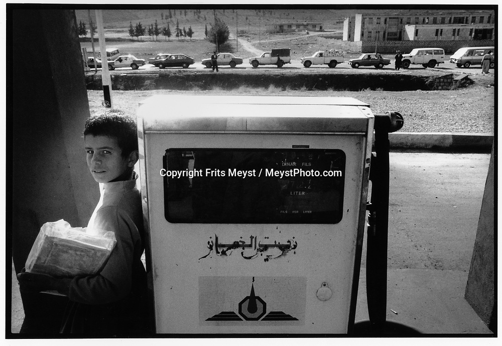 DOHUK, KURDISTAN, IRAQ, 26.11.91. Kurdish people wait in line for petrol.  Due to the UN embargo against Iraq and an Iraqi blockade against Kurdistan, the economy is a disaster ©Photo by Frits Meyst/NewsImages