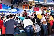 Shoppers sort through piles of assorted clothes sold by the kilo at the Tuesday Market in San Miguel de Allende, Guanajuato, Mexico.