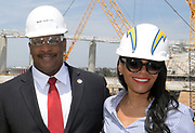 Apr 15, 2019; Inglewood, CA, USA; Inglewood mayor James Butts aka James T. Butts (left) and executive assistant  Melanie McDade-Dickens pose at the LA Stadium & Entertainment District construction site. The site will be the home of the Los Angeles Chargers and the Los Angeles Rams, Super Bowl LVI in 2022, the College Football National Championship in 2023 and the opening and closing ceremonies of the 2028 Olympic Games.