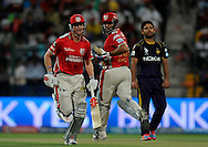 Virender Sehwag of the Kings X1 Punjab and George Bailey captain of the Kings X1 Punjab run between the wickets during match 15 of the Pepsi Indian Premier League 2014 Season between The Kings XI Punjab and the Kolkata Knight Riders held at the Sheikh Zayed Stadium, Abu Dhabi, United Arab Emirates on the 26th April 2014<br /> <br /> Photo by Pal Pillai / IPL / SPORTZPICS