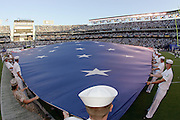 SAN DIEGO - AUGUST 12:  U.S. Military personnel unfold an American flag as part of the pregame festivities at the San Diego Chargers week one preseason game against the Green Bay Packers at Qualcomm Stadium on August 12, 2006 in San Diego, California. The Chargers defeated the Packers 17-3. ©Paul Anthony Spinelli