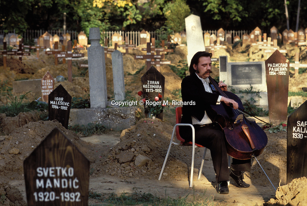 Sarajevo Symphony cellist Vedran Smajlovic plays Tommaso Albinoni's 'Adagio' for victims of the Serb siege of the city, Lion Cemetery, Sarajevo, Bosnia and Herzegovina, September 1992. PHOTO BY ROGER RICHARDS