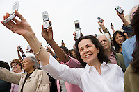 Crowd holding up mobile phones