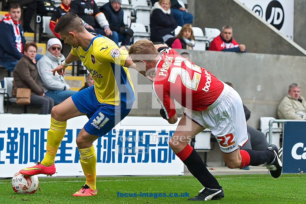 Graham Cummins of Exeter City (left) and P&aacute;draig Amond of Morecambe (right) during the Sky Bet League 2 match at the Globe Arena, Morecambe<br /> Picture by Ian Wadkins/Focus Images Ltd +44 7877 568959<br /> 26/10/2014