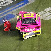 NASCAR Sprint Cup drivers AJ Allmendiner (51) falls to the ground after a wreck during the NASCAR Coke Zero 400 Sprint series auto race at the Daytona International Speedway on Saturday, July 6, 2013 in Daytona Beach, Florida.  (AP Photo/Alex Menendez)